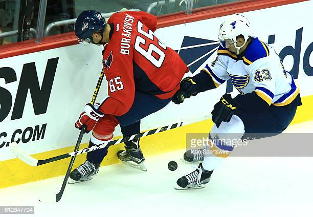 St Louis Blues defenseman Jordan Schmaltz moves in on Washington Capitals left wing Andre Burakovsky during a NHL preseason game at Verizon Center in...