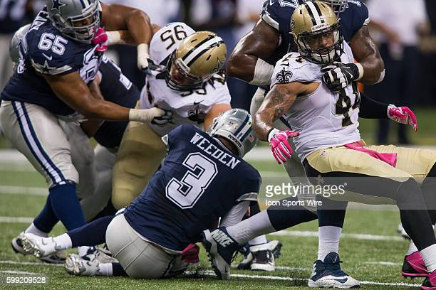 Dallas Cowboys Quarterback Brandon Weeden [17624] is sacked by New Orleans Saints Defensive Tackle Tyeler Davison [20292] during the game between the...