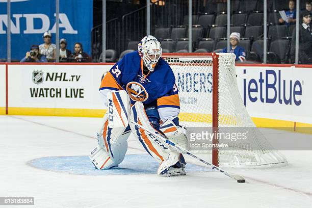 New York Islanders Goalie JeanFrancois Berube sweeps the puck to the side of the net during the first period of a preseason NHL game between the New...