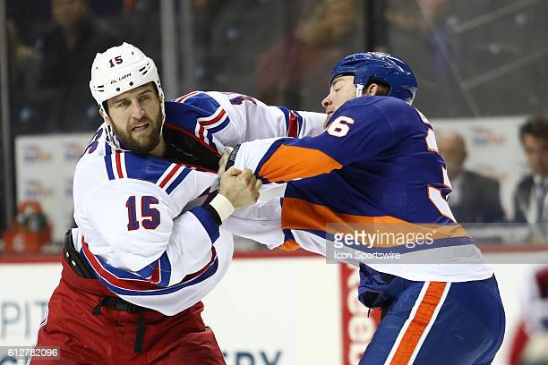 New York Rangers Left Winger Tanner Glass and New York Islanders Left Winger Eric Boulton square off during the first period of a preseason NHL game...