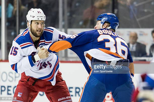New York Rangers Left Winger Tanner Glass and New York Islanders Left Winger Eric Boulton square off during a preseason NHL game between the New York...