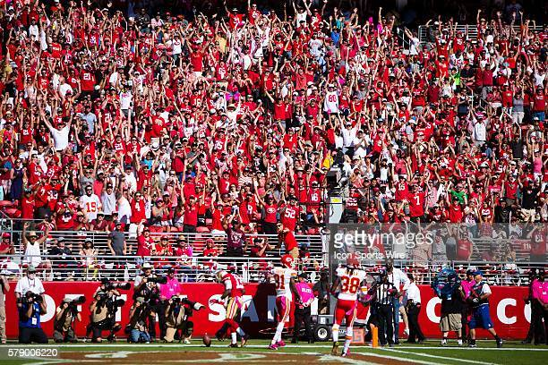 Fans cheer after San Francisco 49ers wide receiver Steve Johnson catches the ball for a touchdown late in the first half, as Kansas City Chiefs...