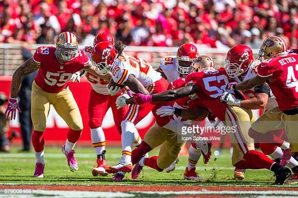 Kansas City Chiefs running back Jamaal Charles is tackled by San Francisco 49ers linebacker Aaron Lynch and San Francisco 49ers inside linebacker...