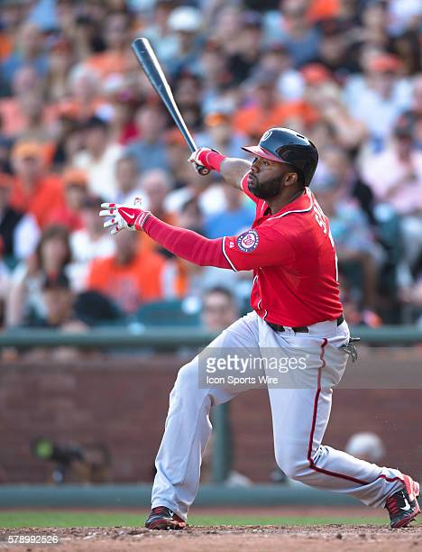 Washington Nationals center fielder Denard Span at bat in the 7th inning and following the trajectory of the ball during game 3 of the National...