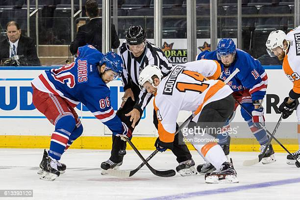 New York Rangers Center Josh Jooris and Philadelphia Flyers Center Sean Couturier face off in the Flyers zone during the first period of a preseason...