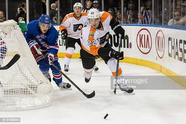 Philadelphia Flyers Right Winger Dale Weise chases a puck behind the Rangers net during the second period of a preseason NHL game between the...