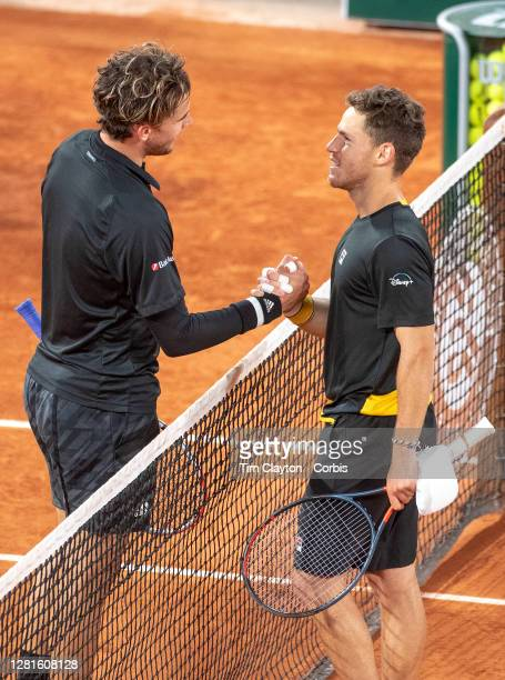 October 06 Dominic Thiem of Austria congratulates winner Diego Schwartzman of Argentina as they meet at the net after the Quarter Finals of the Men's...