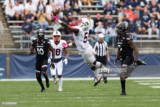 A pass from UConn Quarterback Bryant Shirreffs is just out of the reach of Wide Receiver Noel Thomas Jr during the first half of a NCAA football game...