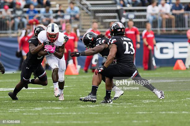 Cincinnati Safety Mike Tyson is the first to get ahold of UConn Running Back Arkeel Newsome during the first half of a NCAA football game between,...