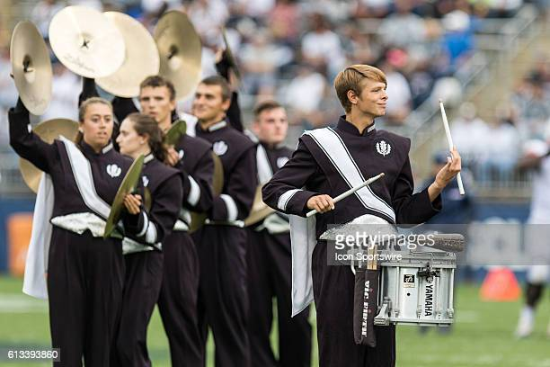 The UConn drum line preforms in between the third and fourth quarter of a NCAA football game between, AAC rivals, the Cincinnati Bearcats and the...