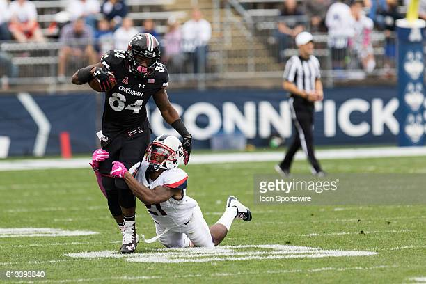 UConn Cornerback Jamar Summers drags down Cincinnati Wide Receiver Nate Cole during the second half of a NCAA football game between AAC rivals the...