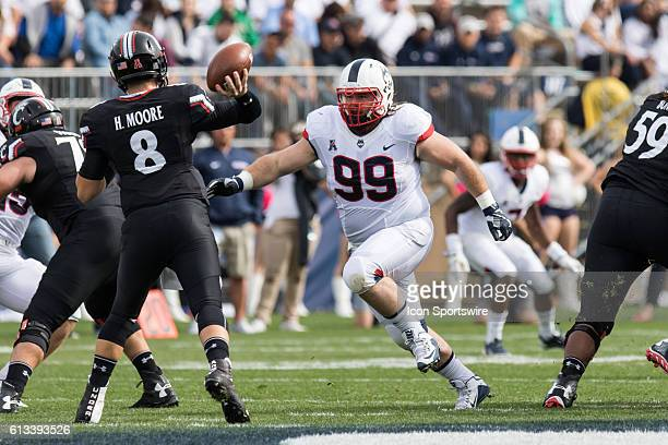 UConn Defensive Line Sean Marinan goes after Cincinnati Quarterback Hayden Moore during the first half of a NCAA football game between AAC rivals the...