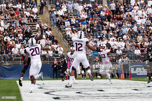UConn Linebacker E.J. Levenberry knocks down a pass from Cincinnati Quarterback Hayden Moore during the first half of a NCAA football game between,...