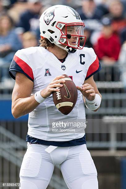UConn Quarterback Bryant Shirreffs fades back to pass during the first half of a NCAA football game between AAC rivals the Cincinnati Bearcats and...
