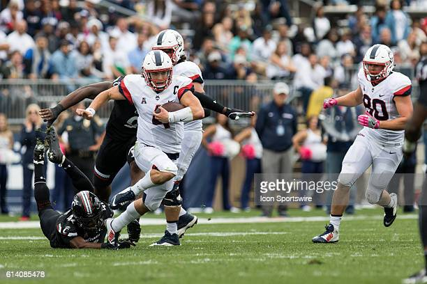 UConn Quarterback Bryant Shirreffs rushes during the second half of a NCAA football game between AAC rivals the Cincinnati Bearcats and the UConn...