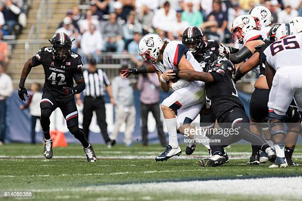 UConn Quarterback Bryant Shirreffs rushes up the middle during the first half of a NCAA football game between AAC rivals the Cincinnati Bearcats and...