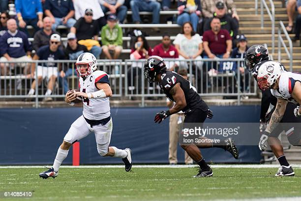 UConn Quarterback Bryant Shirreffs scrambles out of the pocket during the first half of a NCAA football game between AAC rivals the Cincinnati...
