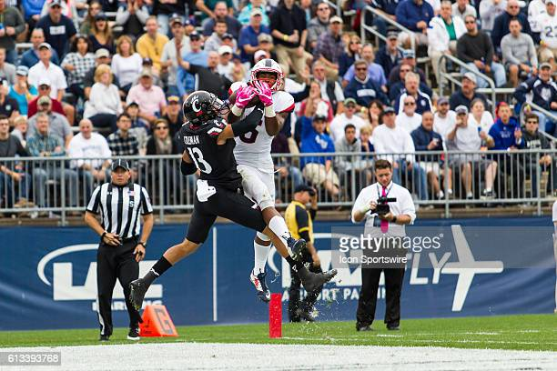 UConn Wide Receiver Noel Thomas, Jr. Catches a 26 yard touchdown pass from Quarterback Bryant Shirreffs during the second half of a NCAA football...
