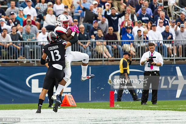 UConn Wide Receiver Noel Thomas Jr catches a 26 yard touchdown pass from Quarterback Bryant Shirreffs during the second half of a NCAA football game...