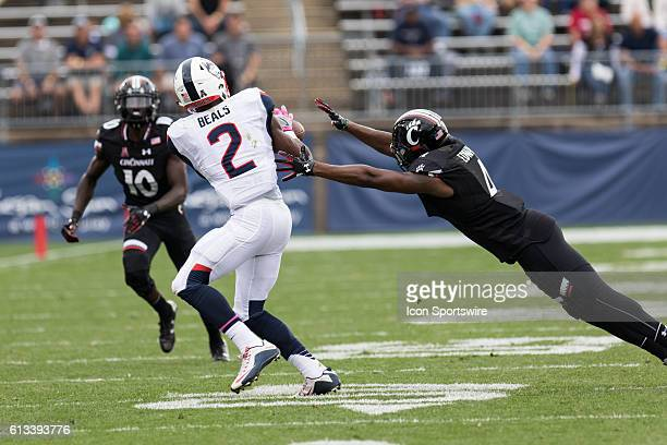 UConn Wide Receiver Tyraiq Beals catches a 59 yard touchdown pass from quarterback Bryant Shirreffs during the first half of a NCAA football game...