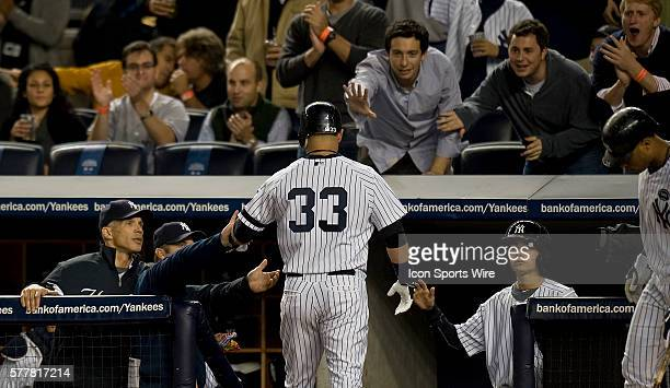 NY Yankees Vs Minnesota Twins Game 3 ALDS Yankees Nick Swisher is greeted by his teammates in the dugout after Swisher scores on Mark Teixeira's RBI...