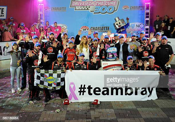 Xfinity Series driver Austin Dillion and his crew celebrate winning the Xfinity Series Drive For a Cure 300 at Charlotte Motor Speedway in ConcordNC