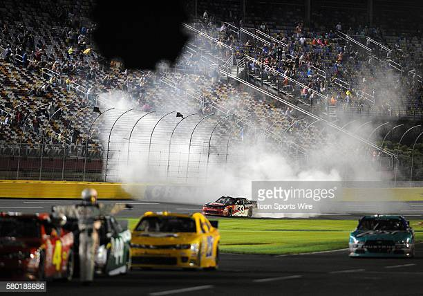 Xfinity Series driver Austin Dillion does a burn out after winning the Xfinity Series Drive For a Cure 300 at Charlotte Motor Speedway in ConcordNC