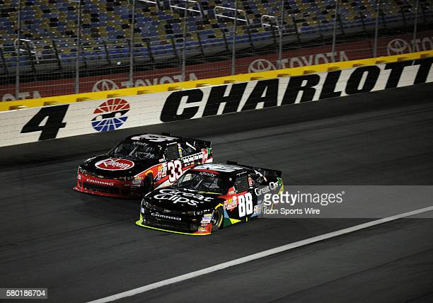 Xfinity Series driver Austin Dillion races to the outside of Xfinity Series driver Kasey Kahne through turn four in the Xfinity Series Drive For a...