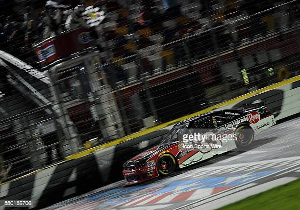 Xfinity Series driver Austin Dillion takes the checkered flag to win the Xfinity Series Drive For a Cure 300 at Charlotte Motor Speedway in ConcordNC