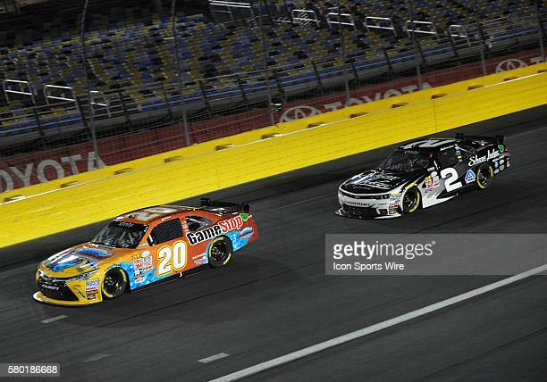 Xfinity Series driver Brian Scott runs behind Xfinity Series driver Erik Jones in the Xfinity Series Drive For a Cure 300 at Charlotte Motor Speedway...