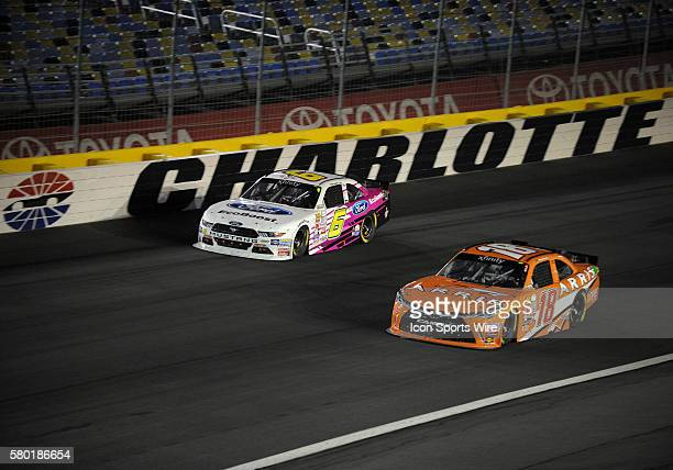 Xfinity Series driver Darrell Wallace Jr races to the outside of Xfinity Series driver Daniel Suarez during the Xfinity Series Drive For a Cure 300...