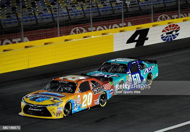 Xfinity Series driver Erik Jones is followed through turn four by Xfinity Series driver Chris Buescher in the Xfinity Series Drive For a Cure 300 at...
