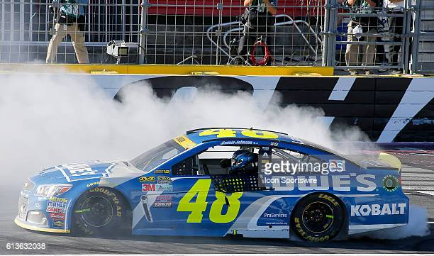 Jimmie Johnson wins the rain delayed Bank of America 500 NASCAR Sprint Cup series race at the Charlotte Motor Speedway in Concord NC