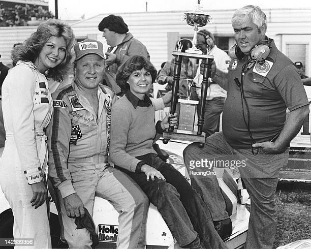 Miss Winston driver Cale Yarborough Yarborough's wife Betty Jo and car owner Junior Johnson in victory lane at North Wilkesboro Speedway after...