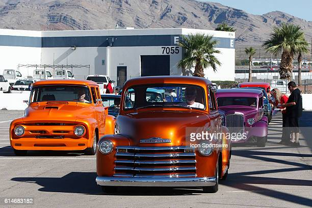 Cars line up to register for the Show Shine Car Show during the 350 Fest prior to the DC Solar 350 NASCAR Camping World Truck Series race at Las...