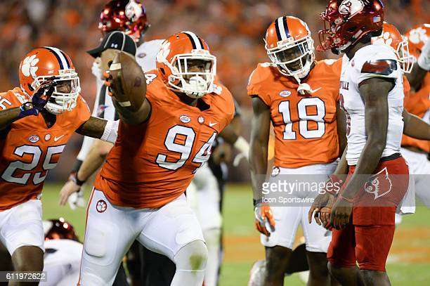 Clemson defensive lineman Carlos Watkins recovers a fumble during 1st half action between the Clemson Tigers and the Louisville Cardinals at Memorial...