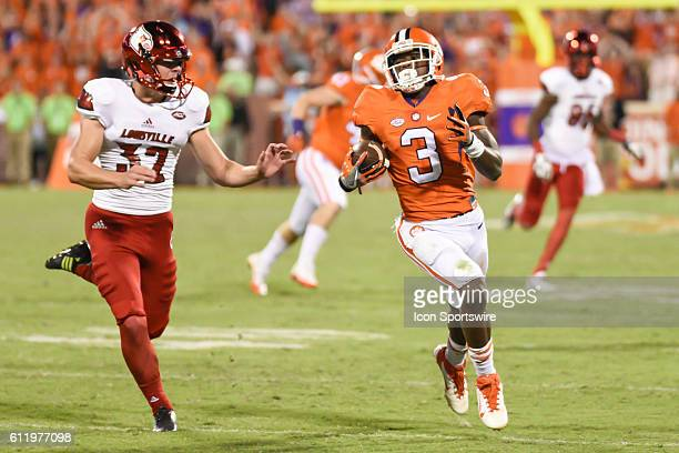 Clemson wide receiver Artavius Scott returns a kickoff during 2nd half action between the Clemson Tigers and the Louisville Cardinals at Memorial...