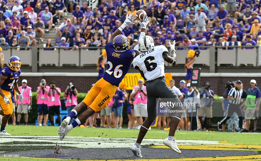 East Carolina Pirates defensive back Colby Gore (26) intercepts a pass intended for UCF Knights wide receiver Tristan Payton (6) in a game between the East Carolina Pirates and the Central Florida Knights at Dowdy-Ficklen Stadium in Greenville, NC. Central Florida defeated East Carolina 47 - 29.