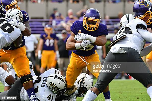 East Carolina Pirates running back Devin Anderson runs with the ball in a game between the East Carolina Pirates and the Central Florida Knights at...