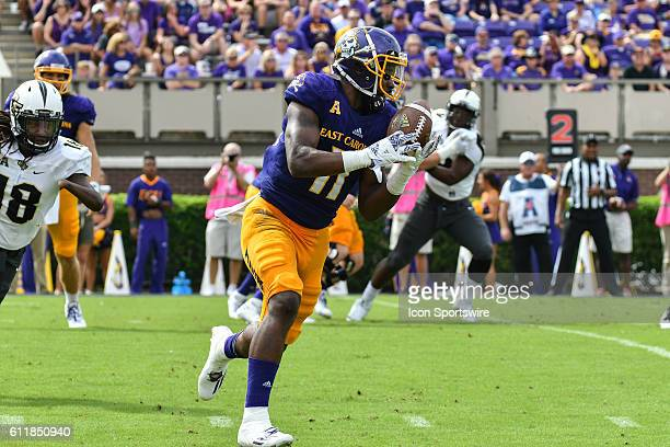 East Carolina Pirates wide receiver James Summers catches a pass in a game between the East Carolina Pirates and the Central Florida Knights at...