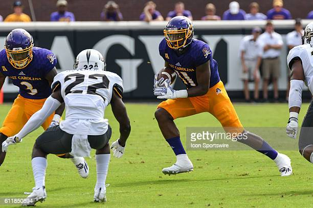 East Carolina Pirates wide receiver James Summers runs with the ball in a game between the East Carolina Pirates and the Central Florida Knights at...