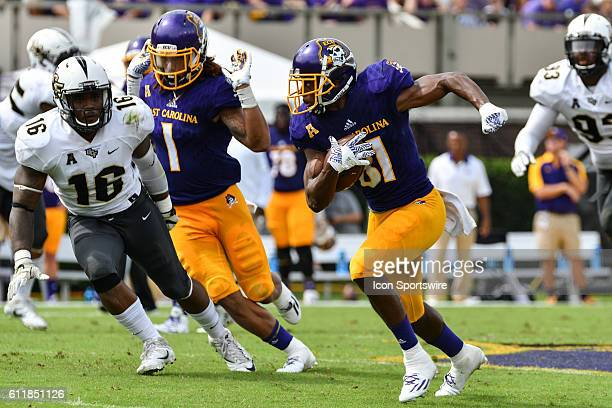 East Carolina Pirates wide receiver Jimmy Williams runs with the ball in a game between the East Carolina Pirates and the Central Florida Knights at...
