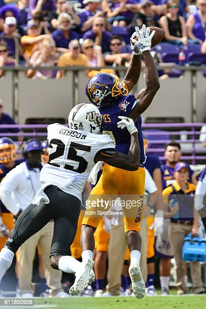 East Carolina Pirates wide receiver Zay Jones catches a pass over UCF Knights defensive back Kyle Gibson in a game between the East Carolina Pirates...