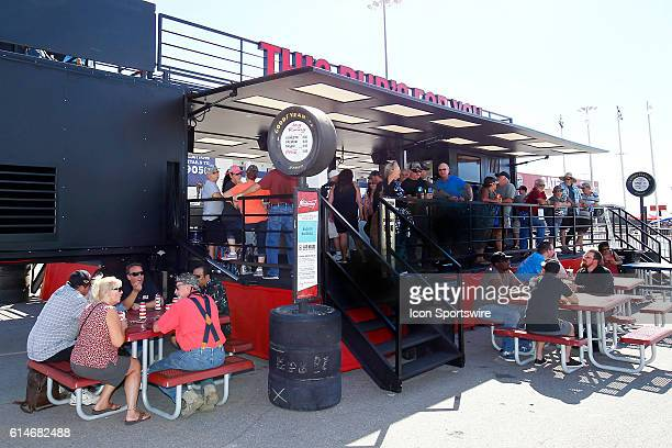 Fans enjoy the Budweiser Beer Garden during the 350 Fest in the Fan Engagement Area prior to the DC Solar 350 NASCAR Camping World Truck Series race...