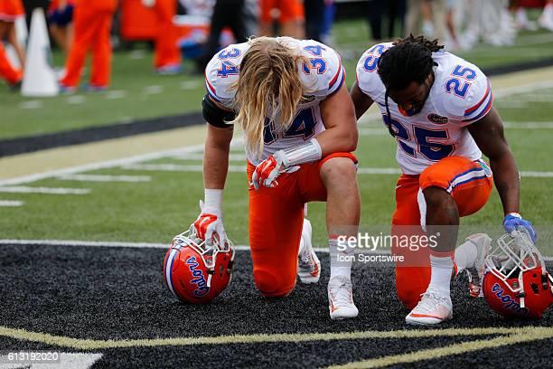 Florida Gators inside linebacker Alex Anzalone and Florida Gators running back Jordan Scarlett pray before a 136 win by Florida over Vanderbilt at...