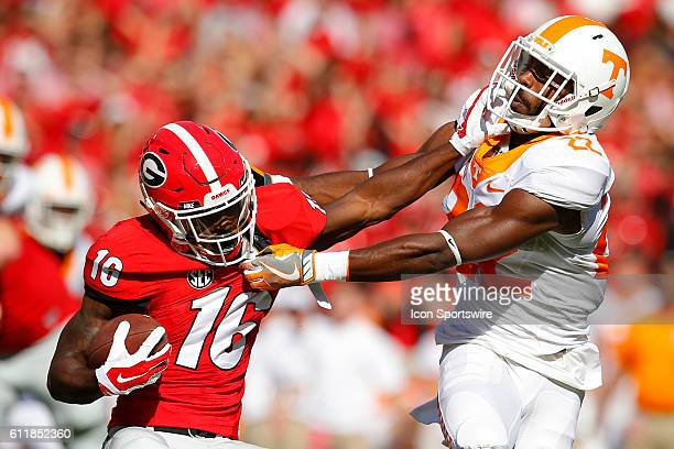 Georgia Bulldogs wide receiver Isaiah McKenzie stiff arms Tennessee Volunteers defensive back Micah Abernathy in first half action of the Tennessee...