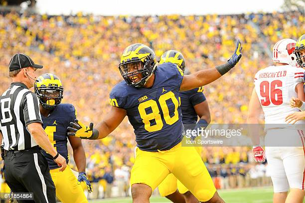 Michigan Wolverines fullback Khalid Hill celebrates his touchdown in the first quarter during the game on Saturday afternoon Michigan Stadium Ann...