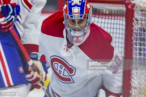 Montreal Canadiens Zachary Fucale watches the puck in front of his net during warmup before National Hockey League preseason action between the...