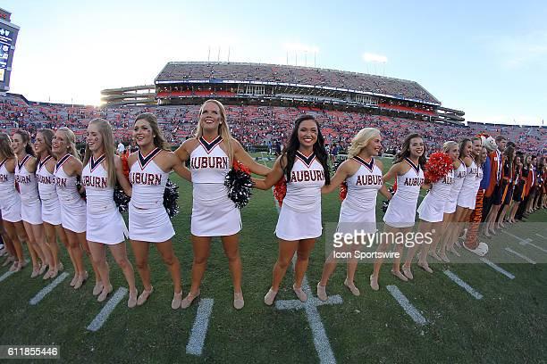 The Auburn Tigers cheerleaders sing the Alma Mater following an NCAA football game between the Auburn Tigers and the LouisianaMonroe Warhawks at...