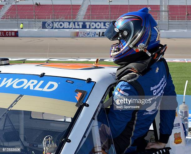 Truck Series Chase contender Ben Kennedy Jacob Chevrolet GMS Racing climbs into truck during the NASCAR Camping World Truck Series DC Solar 350 at...